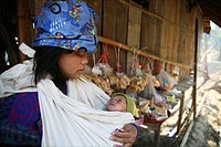 A young girl cradles a baby in Mae Sot refugee camp Around 130,000 Burmese refugees have settled in Thailand due to opression in their homeland of Mya...