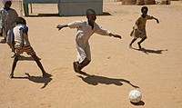 Refugee children playing football