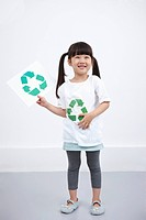 A girl wearing recycling shirt with recycling mark