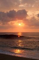 Wave Washing Onto Beach At Sunset