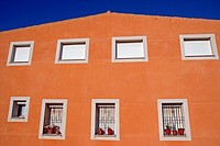 residential building, Cervera, houses, windows, shutters, fences, planters, asymmetric, blue sky, architectural, color, horizontal