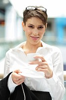 Young businesswoman holding a cup of coffee