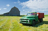 abandoned barn and old farm truck, near Ponteix, Saskatchewan, Canada