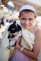 A young girl proudly holds up her rabbit at the 2007 San Mateo County Fair, San Mateo, California, USA