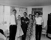 Nixon family heartbroken but smiling in the White House solarium on last full day of his presidency Aug. 8 1974. L to R Edward Cox Tricia Nixon Cox Ri...