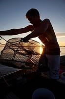 Youth Setting Prawn Traps, Fishing, Boating, Calm, Summer, Sunset, Savary Island, Strait of Georgia, Sunshine Coast, B.C., Canada