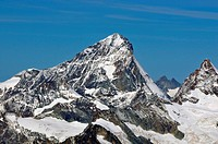 The Dent Blanche flanked by the Grand Cornier in the Swiss Alps above Zermatt in the summer