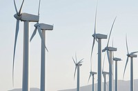 forefront of a group of windmills for renewable electric energy production