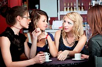 Conversation among four pretty teenaged girls in a bistro