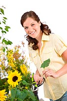 Gardening _ smiling woman with sunflower and pruning shears on white background