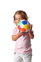 Toddler girl playing with a colored ball on white background