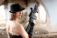 A sexy woman with an assault rifle.