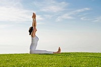 Young woman practising Hatha yoga outdoors, showing the pose dandasana, staff pose, Nove Mesto, Okres Teplice, Czech Republic, Europe