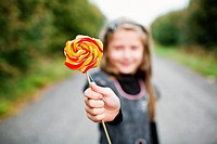 An image of little girl wit lollipop in his hand