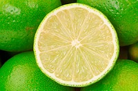 close_up of half lime with whole limes