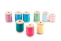 Spools of different colors thread isolated on white background