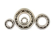 Four steel ball bearings isolated on a white background