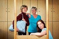 Three happy woman smiling in changing room