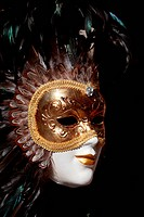 Close up image of a venetian mask on a souvenir shop stand in Venice,Italy.