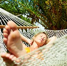 woman relaxing on hammock with eyes closed. Front view, Square shape