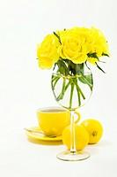 Cup of hot tea, lemons and beautiful roses