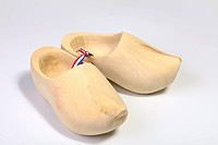 Two natural wooden clogs with dutch flag