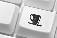 The button with an emblem of a cup of coffee on the keyboard. A working break.