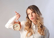 Woman holding an alarm clock