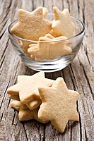 Sugar coated shortbread cookies in star shapes stacked up