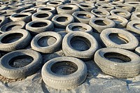 group of old tires and abandoned on black plastic