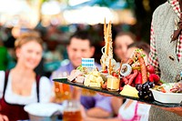 In Beer garden in Bavaria, Germany _ beer and snacks are served, focus on meal