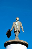 Businessman, sculpture on an advertising column, Duesseldorf, North Rhine_Westphalia, Germany, Europe