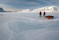 Cross_country skiers with pulkas crossing a frozen fjord, Tempelfjorden, Spitsbergen, Svalbard, Norway, Europe