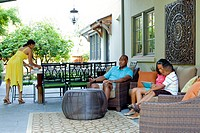 African American family relaxing on patio