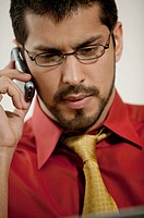 Serious businessman talking on cell phone