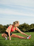 Caucasian woman stretching before exercise
