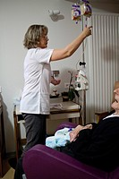 Photo essay in a retirement home at Notre_Dame_de_Gravenchon, France. Nurse.