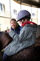 Photo essay at EQUISENS, a therapeutic riding centre in Asniere_les_Dijon France. Hippotherapy session with a child having autistic disorders and psyc...