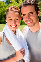 Woman holding a towel around her neck smiling with a man