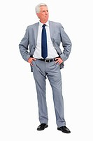 Businessman with her hands on her hips against white babckground