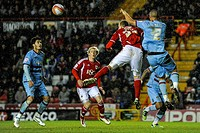 17 04 2012 Bristol, England Bristol City Midfielder Stephen Pearson SCO and West Ham Defender Winston Reid NZL compete in the air during the second ha...