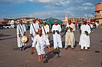 Gnaoua musicians performing traditional dances and music on the Jemaa el-Fnaa square, Marrakech, Morocco, Africa