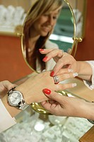 Young woman trying on a ring in a jewellery store