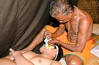 The make_up of the Kathakali character Krishna is being applied, Perattil, Kerala, India, Asia