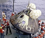 Crewmen hoist the Apollo 13 Command Module Odyssey aboard the U.S.S. Iwo Jima. The spacecraft splashed down at 12:07:44 p.m., April 17, 1970 in the So...