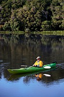 Kayaking on the Pieman River, near Corinna  The Tarkine, Tasmania, Australia