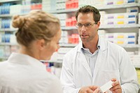 Pharmacist teaching patient about drug