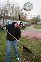 Detroit, Michigan - Volunteers from Chrysler Corp  clean trash and leaves from a park