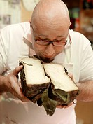 Leonardo Spulica savoring the precise smell of Pecorino Cheese in his cacioteka delicatessan store in Perugia, Italy