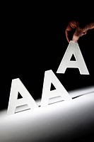 This illustration picture shows Triple ´A´ Letters AAA with third A being removed. The top three rating agencies __ Moody´s, with Standard and Poor´s ...